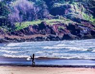 Surfer near Cannon Beach