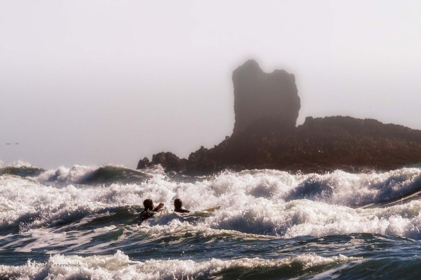 Surfers near Cannon Beach. OR